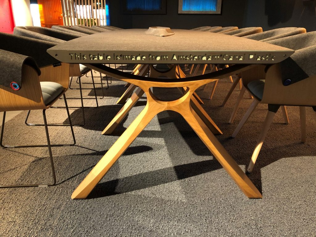 Office boardroom table made from recycled canal plastic