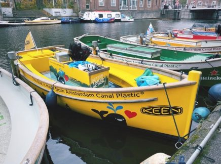 Special boat on an Amsterdam canal designed to fish plastic waste out of the canal